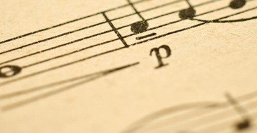 Classical music - notes on yellowed vintage paper sheet