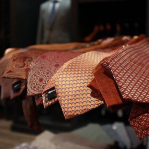 Example 2: This photo takes a unique look at NW-ISBDC client Rusted Oak's tie offerings. The dark and blurry background offers a nice foil to the lighted tie arrangement.